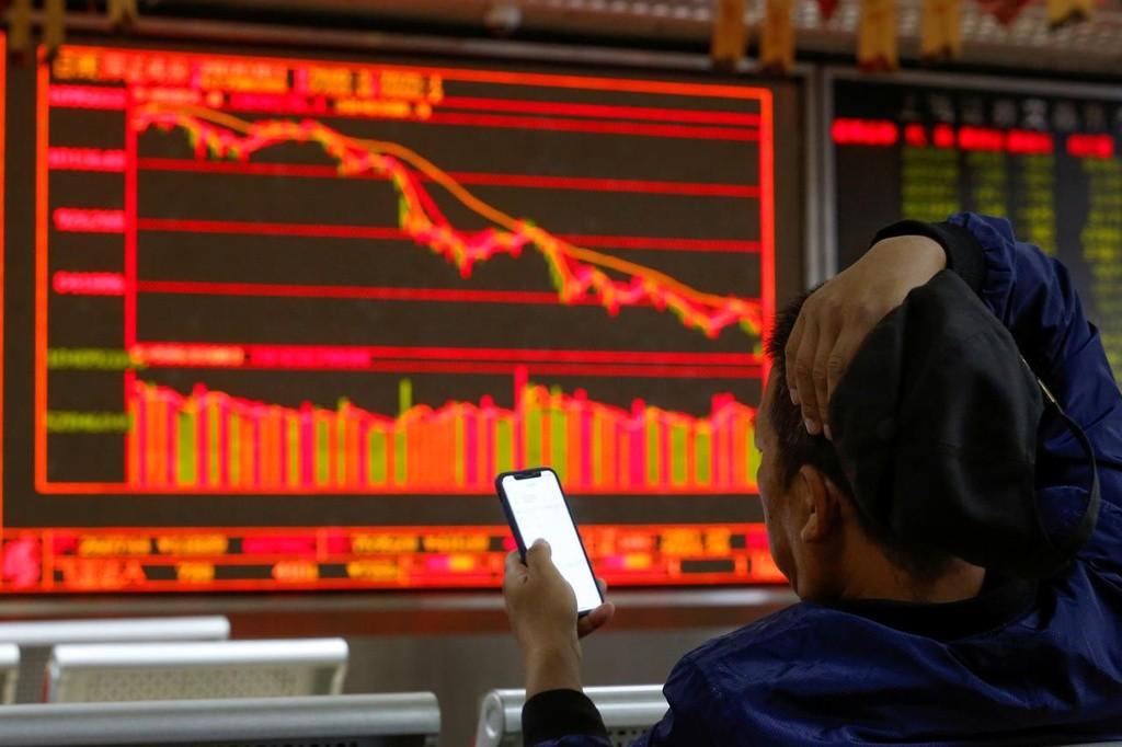 Làn sóng vỡ nợ làm chao đảo thị trường nợ Trung Quốc