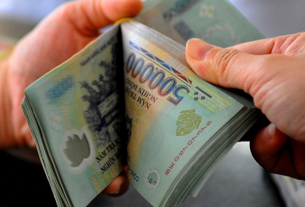 Doanh nghiệp phải đền bù nếu trả chậm lương cho người lao động