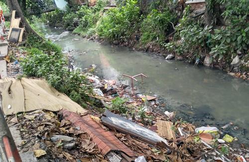 Lắp camera tìm người xả thải gây nghẽn dòng chảy sân bay Tân Sơn Nhất